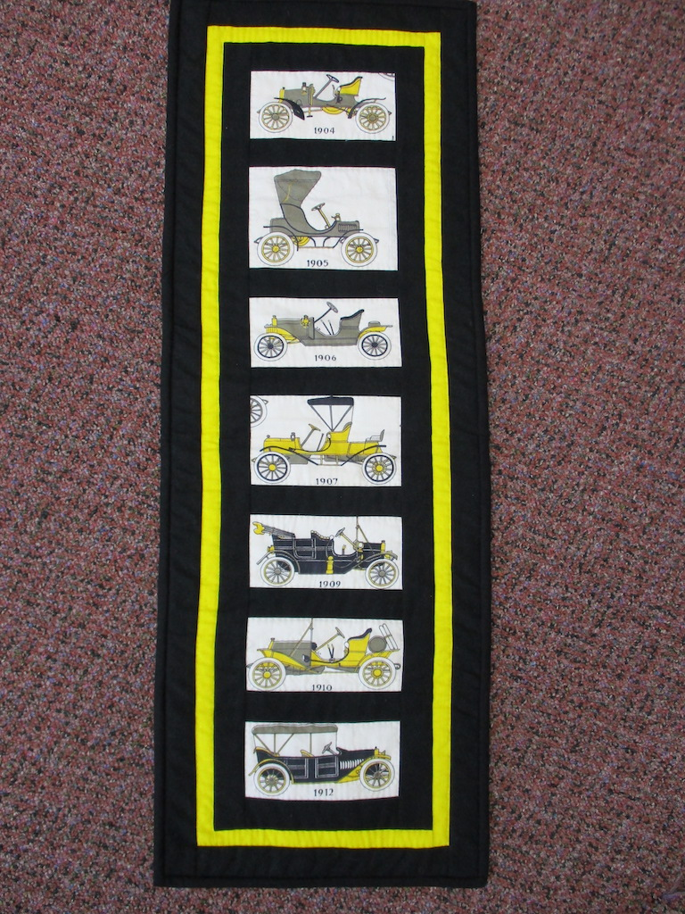 146, VINTAGE CARS (signed and dated), 10x28, Pieced, Quilted and Donated by Janet Runion Patton