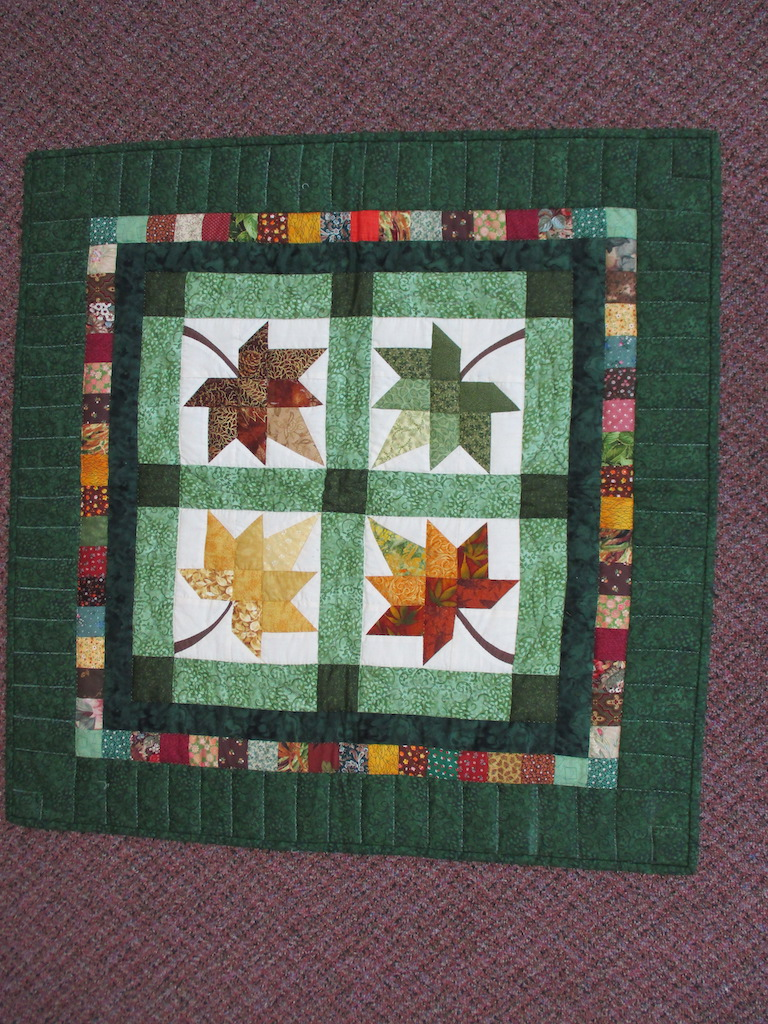 170, AUTUMN SPLENDOR, 34x34, Pieced, Donated and Quilted by Mary Jane Horning