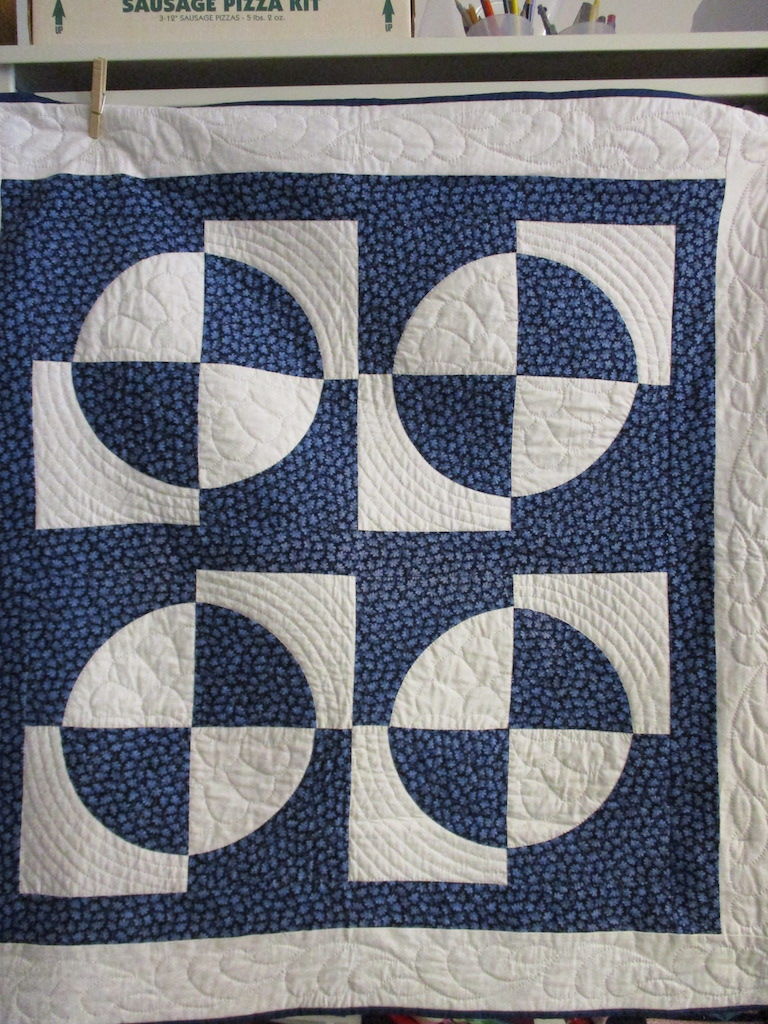 70, WHEELS (signed and dated), 38x40, Pieced by Ann Grapes, Quilted by Marie Eby