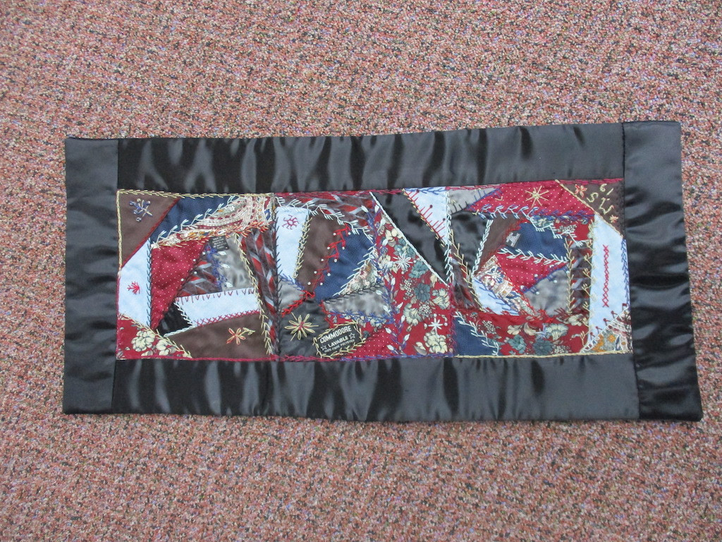 174, NECKTIE CRAZY PATCH (signed and dated), 11x25, Pieced and Donated by Maribelle Steffy