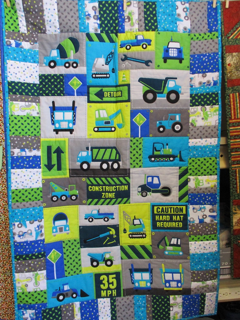 176, WORK ZONE PREPRINT (signed and dated), 33x52, Pieced by Susie DeVos, Quilted by Janet Crider