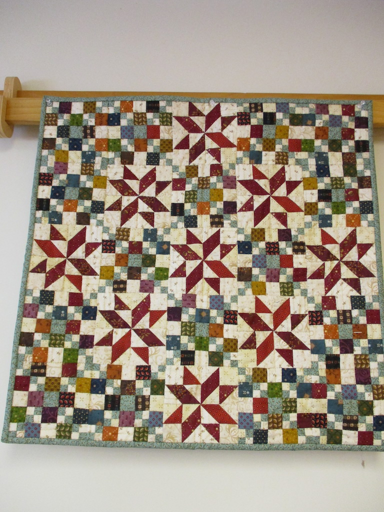 185, SKIP TO MY LOU (signed and dated), 24x24, Pieced by Sandi Layton, Quilted by Fannie Frey