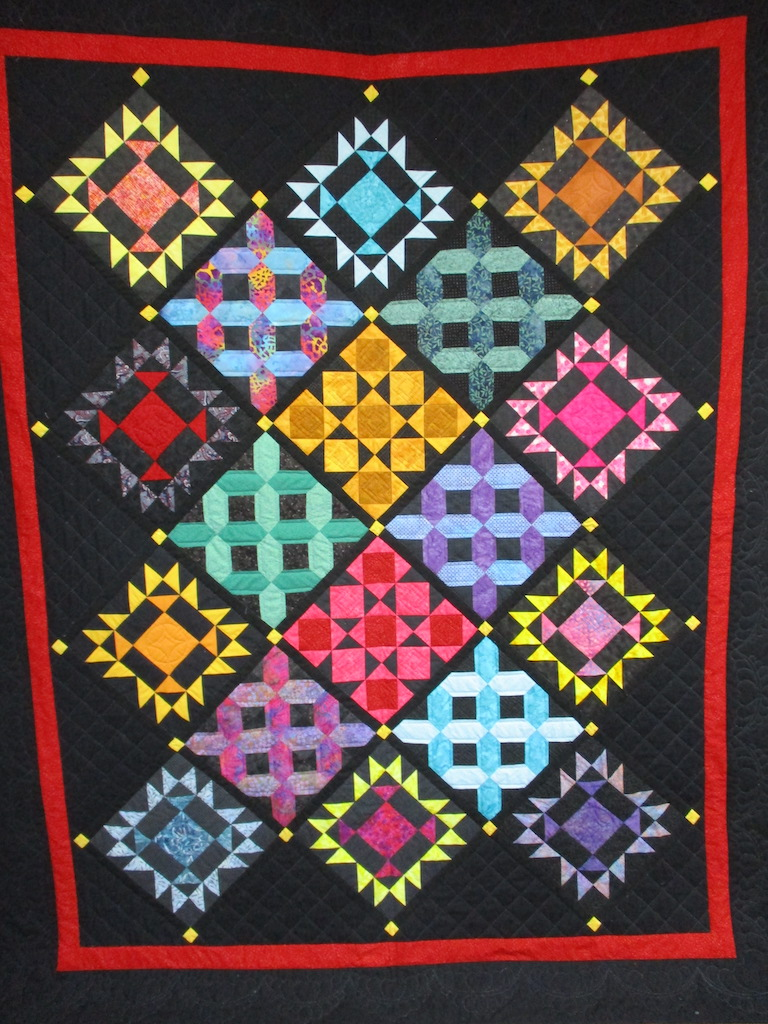 187, ALMOST AMISH (signed and dated), 72x92, Pieced and Donated by Cathy Irwin and friends, Quilted by MCC volunteers