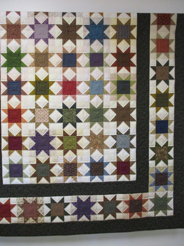194, SCRAPPY STARS, 90x108, Pieced by Connie Lapp, Quilted by MCC volunteers
