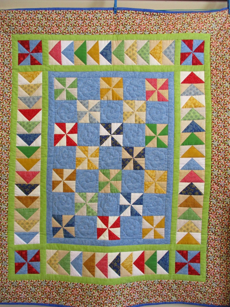 197, PINWHEEL GEESE (signed and dated), 41x48, Pieced by Carol Schwam, Quilted by Susie DeVos
