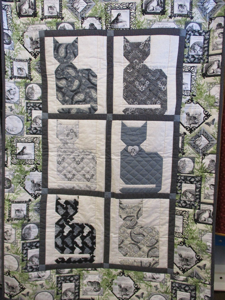 203, CAT-CENTRIC (signed and dated), 35x50, Pieced by Dorothy Crider, Quilted by Janet Crider