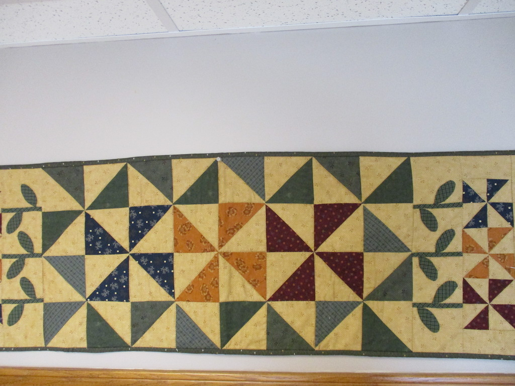 223, BLOOMIN' PINWHEELS (signed and dated), 16x50, Pieced and Appliqued by Dorothy Crider, Quilted by Fannie Frey