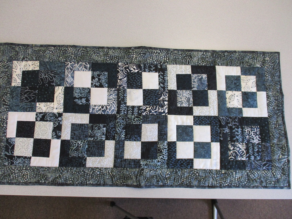 222, FOUR SQUARE (signed and dated), 22x46, Pieced by Joan Norcross, Quilted by Susie DeVos