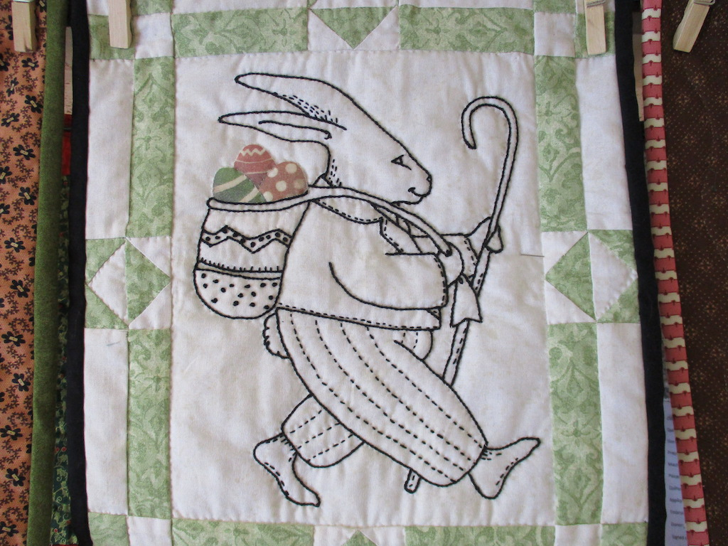 242, PHILIP THE RABBIT (signed and dated), 12x14, Pieced and Embroidered by Monna Gayman, Quilted by Marie Eby