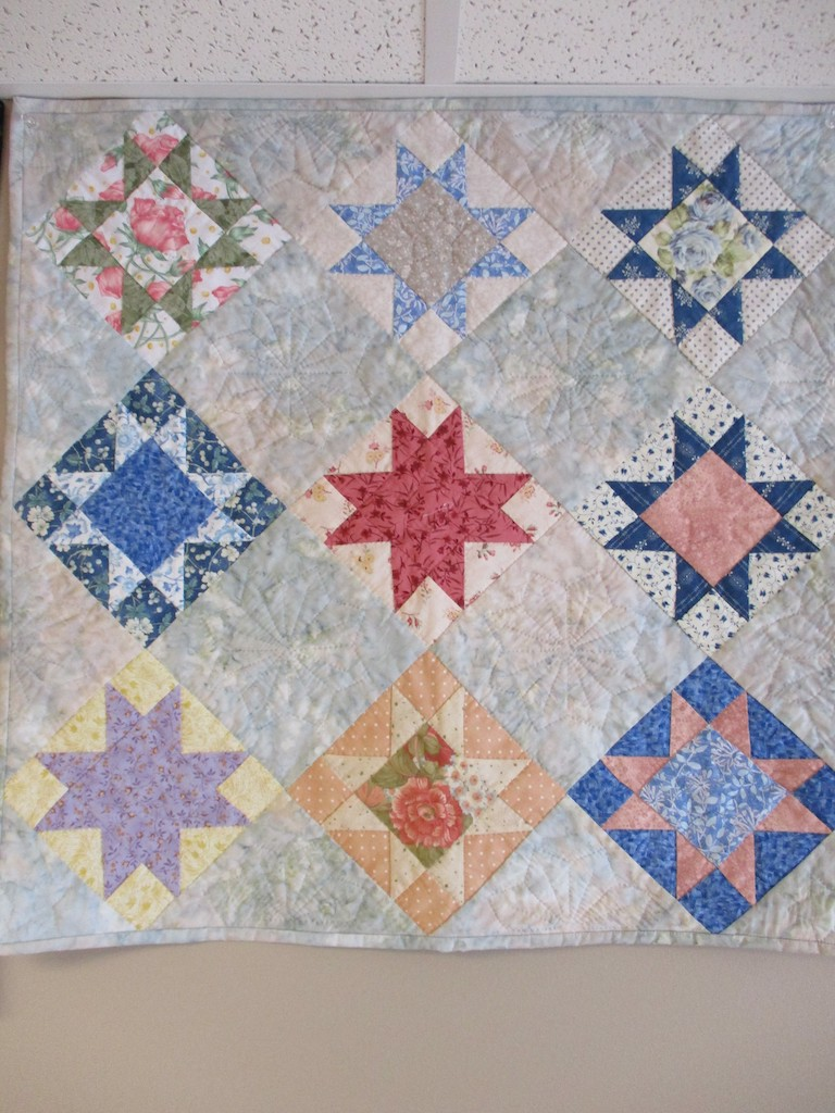 255, OHIO STAR (signed and dated), 22x26, Pieced by Karen Manderson, Quilted by Nancy Cordell