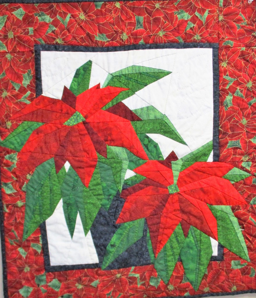 258, POINSETTIA (signed and dated), 23x36, Pieced by Dorothy Crider, Quilted by Marie Eby