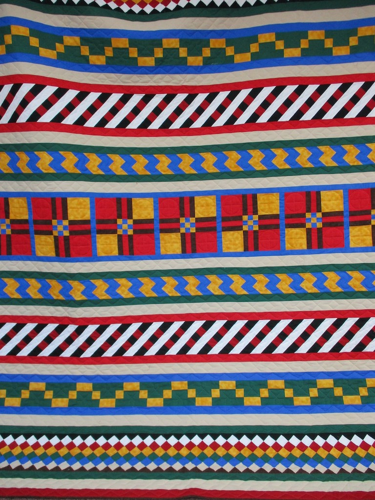 270, SEMINOLE PATCHWORK (signed and dated), 85x103, Pieced, Quilted and Donated by June Miller