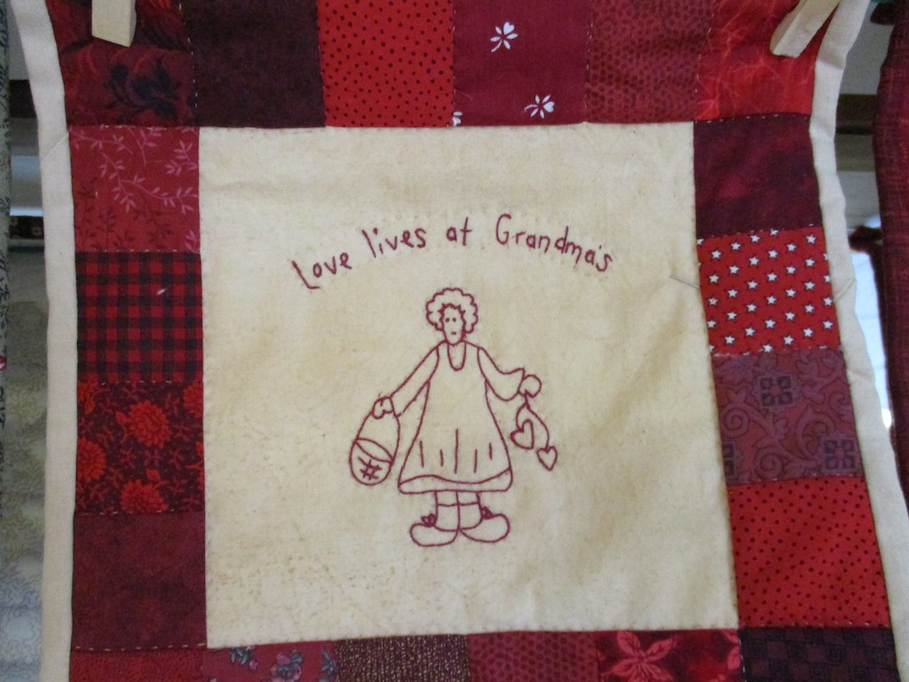 278, LOVE LIVES AT GRANDMA'S (signed and dated), 9x9, Pieced and Embroidered by Carlene Brenize, Quilted by Fannie Frey