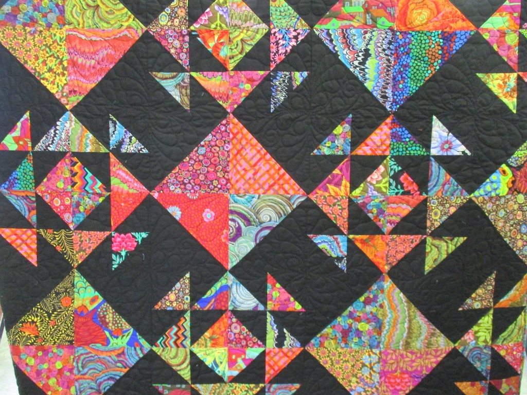 282, CARNIVAL (machine quilted), 62x78, Pieced by Lynda Ainsworth, Machine quilted by Edie Kaple
