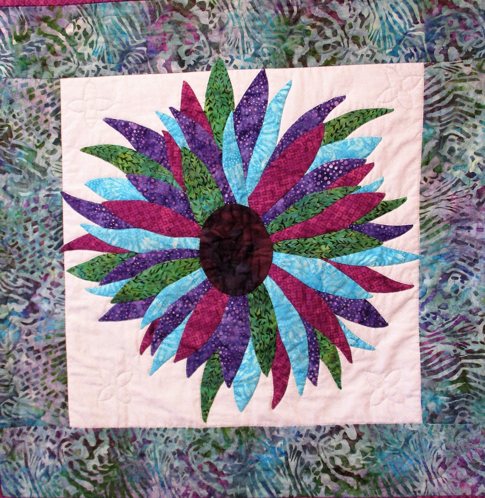 283, FIERY FLOWER (signed and dated), 30x30, Pieced by Dorothy Crider, Quilted by Fannie Frey