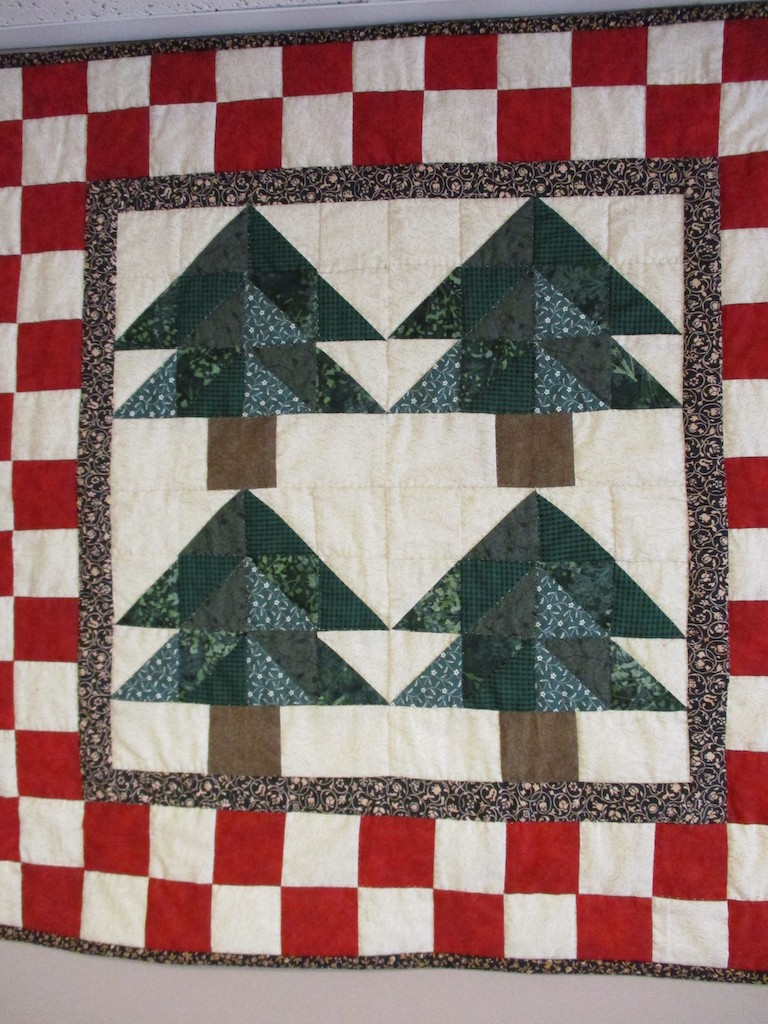 285, TIMBER TREES (signed and dated), 25x25, Pieced by Joan Norcross, Quilted by Marie Eby