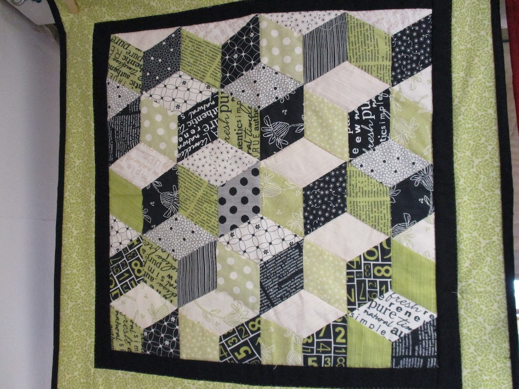 293, TUMBLING BLOCKS (signed and dated), 22x22, Pieced by Susie DeVos, Quilted by Fannie Frey