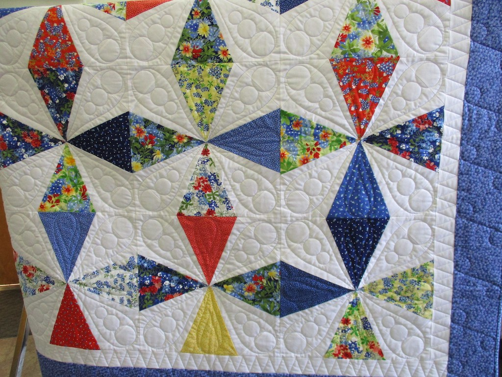 294, BLUEBERRY BUCKLE (machine quilted, signed and dated), 63x63, Pieced by Lynda Ainsworth, Machine quilted by Edie Kaple