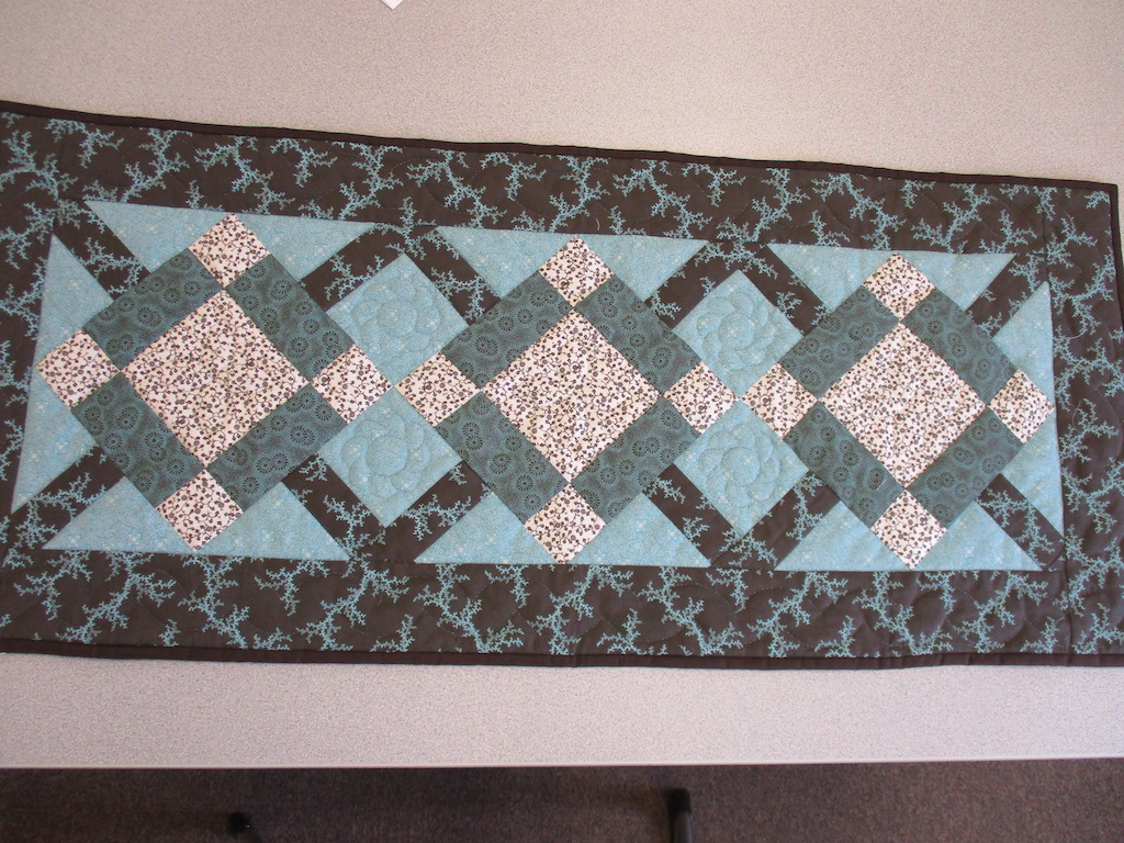 317, HUGS AND KISSES (signed and dated), 18x42, Pieced by Joan Norcross, Quilted by Fannie Frey