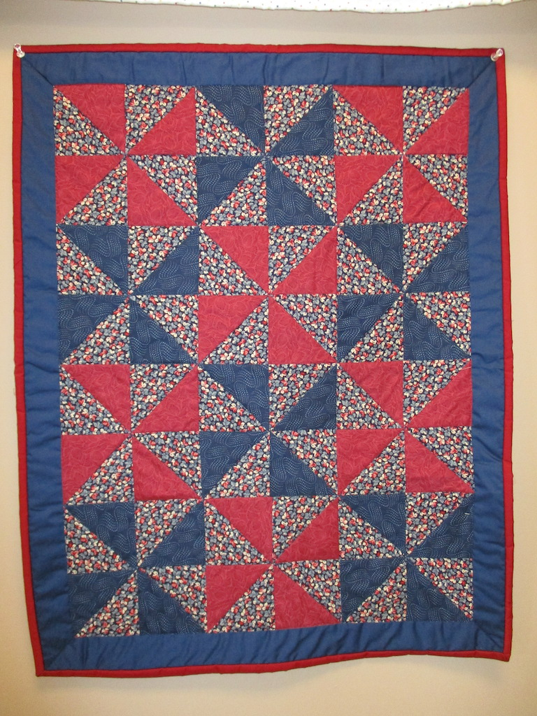 320, PINWHEEL (signed and dated), 22x28, Quilted by Fannie Frey, Donated by The Cumberland Valley Relief Center