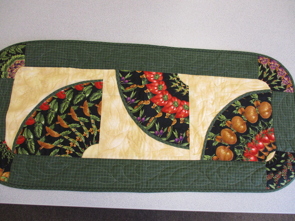 324, VEGETABLE TABLE RUNNER (signed and dated), 20x36, Pieced by Karen Manderson, Quilted by Susie DeVos