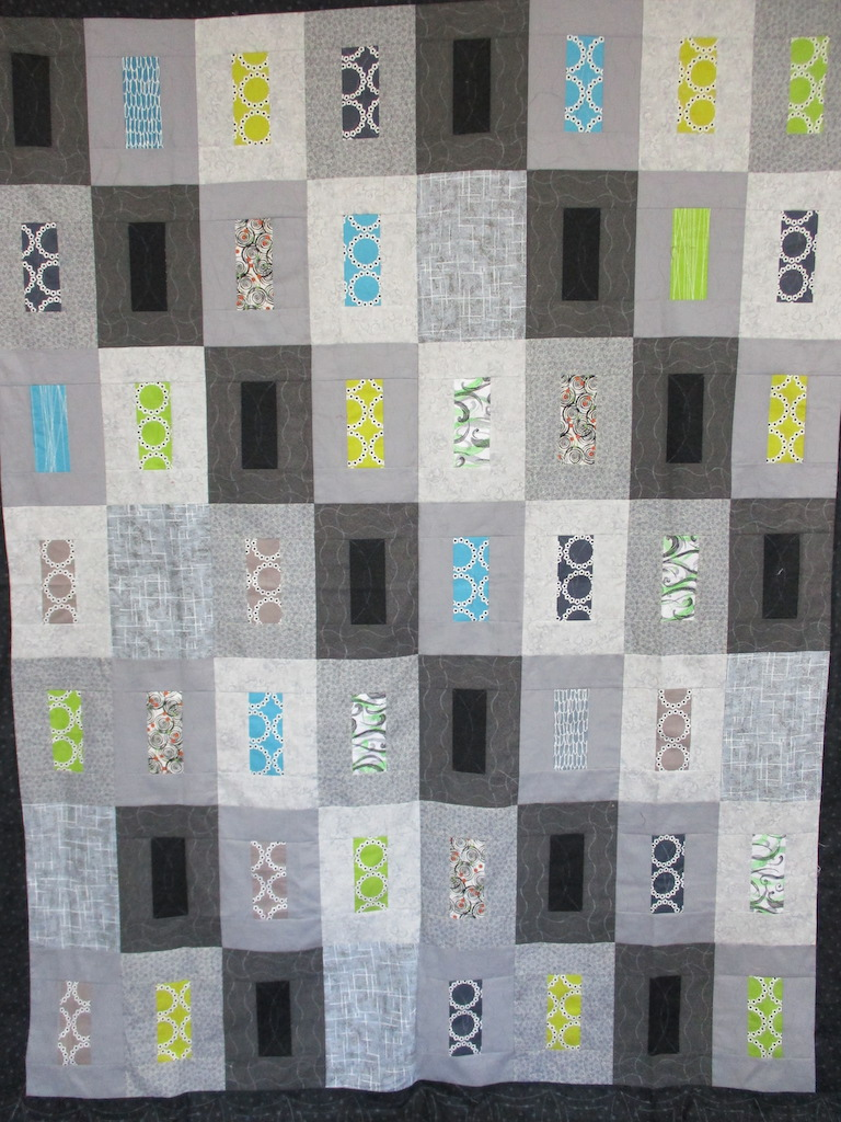 345, URBAN ATTITUDE, 72x88, Pieced by Connie Lapp, Quilted by MCC Volunteers