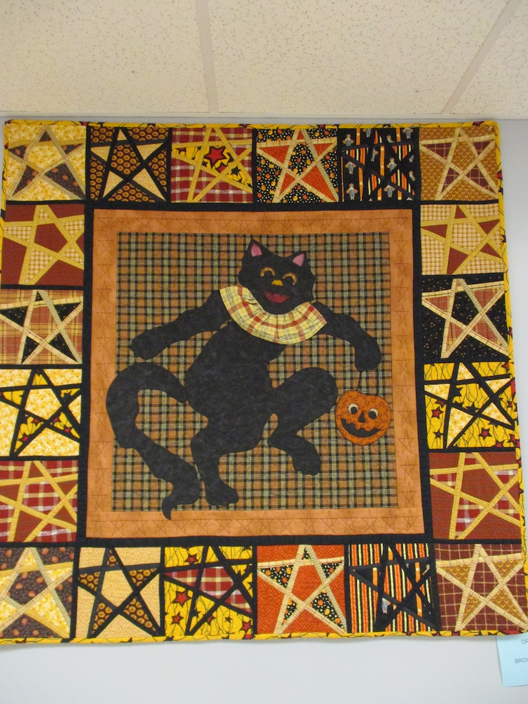 358, BLACK CAT (machine quilted, signed and dated), 50x50, Pieced and Machine quilted by Judith McLean