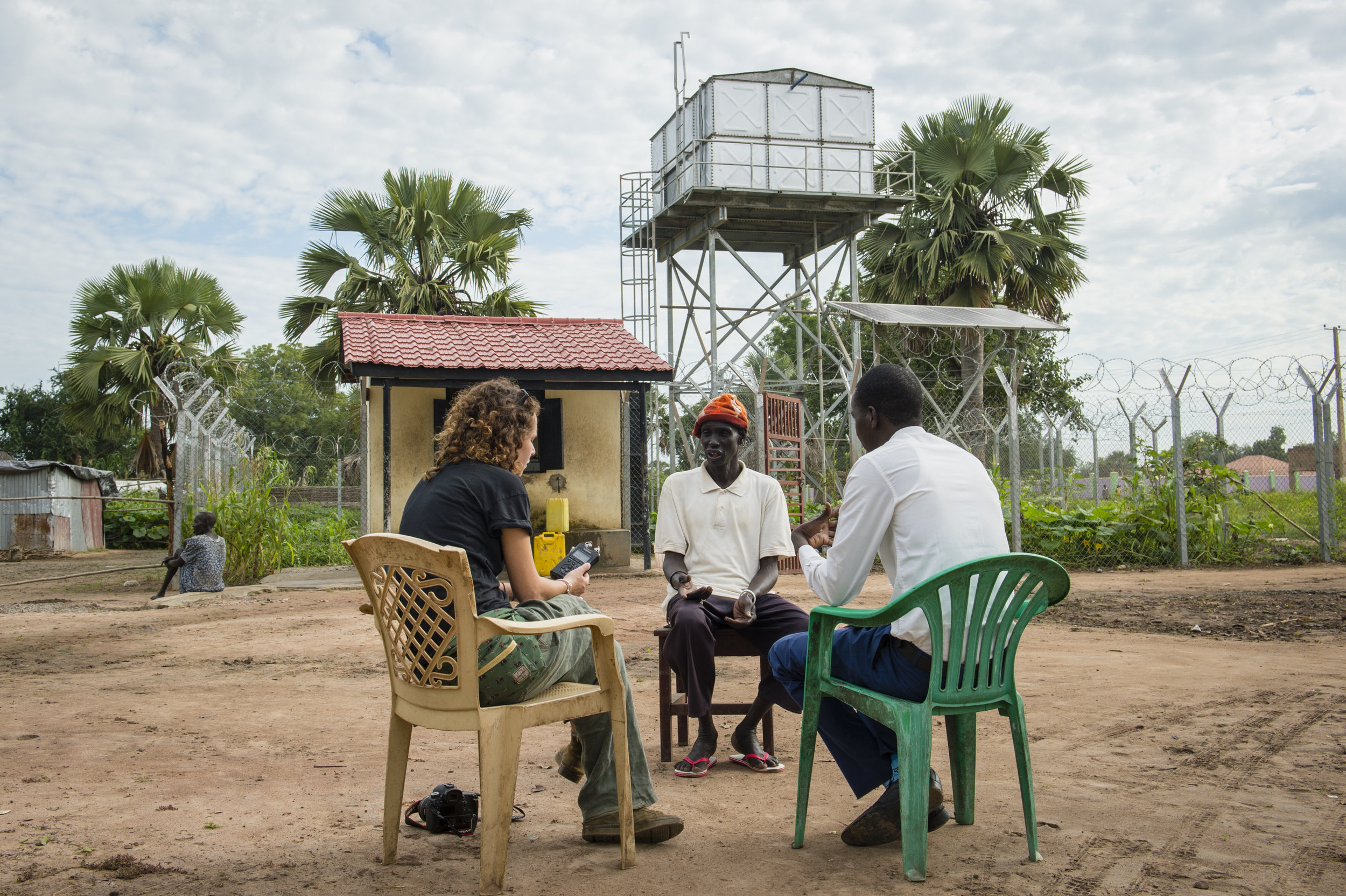 The Water Yard - Ellie interviewing the community delegate who operates one of 'Water for Lakes' solar powered water yards in Rumbek, South Sudan. Assignment on behalf of Mott MacDonald and the Dutch Government.
