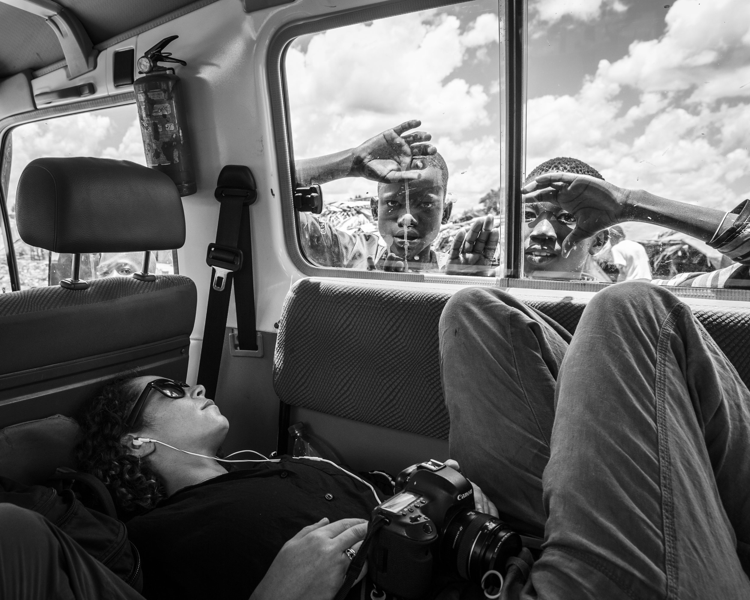 Backstage with Sheeko - On assignment with Sheeko Productions. Photo taken somewhere on a waterlogged road during a six hour drive in the Western Lakes State, South Sudan.