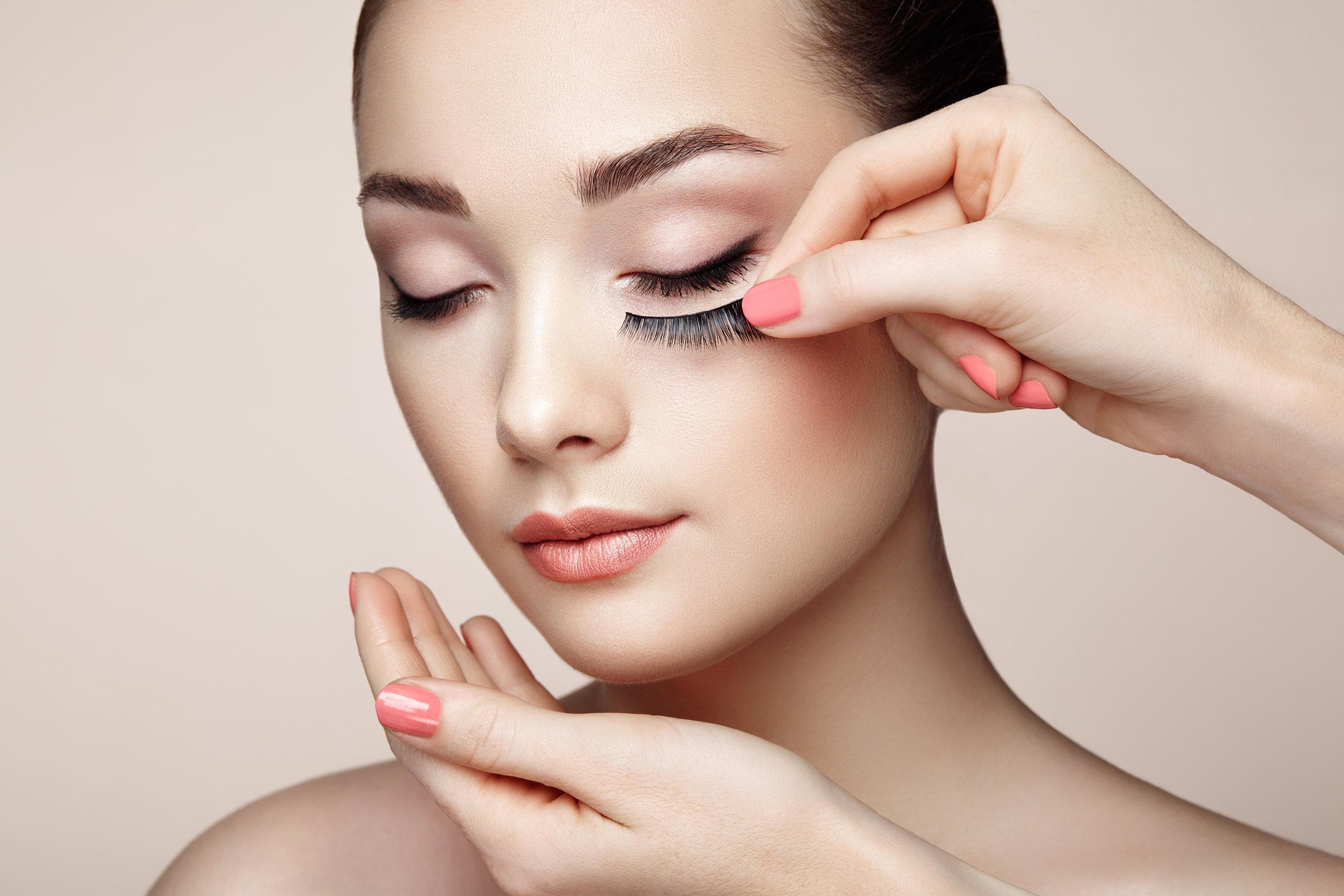 makeup-artist-glues-eyelashes-PKSFGQR.jpg