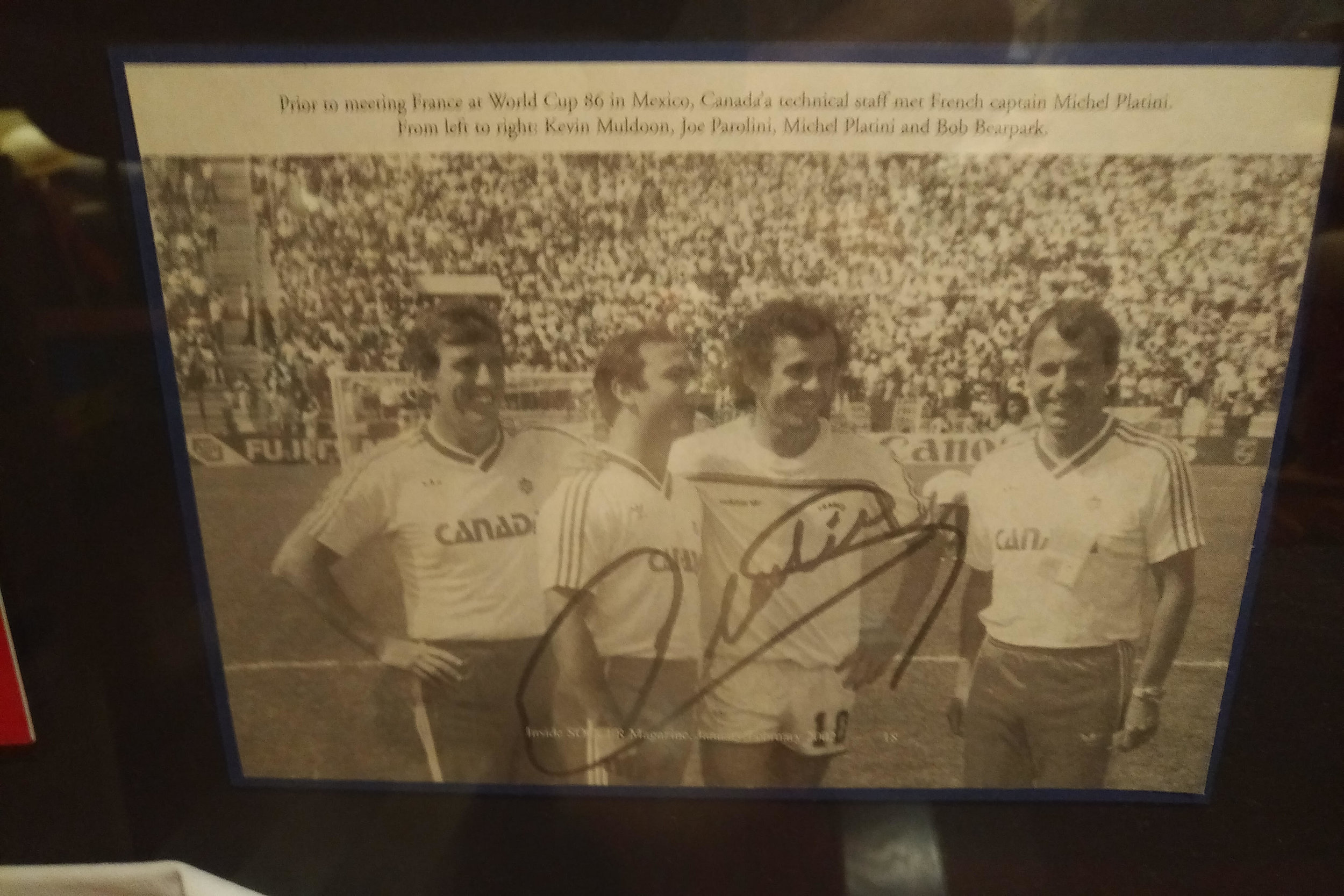 Photo with France + Juventus Captain, Michel Platini, prior to kick off between Canada & France in Azteca Stadium at the 1986 World Cup in Mexico. L-R (Kevin Muldoon, Joe Parolini, Michel Platini, & Bob Bearpark).