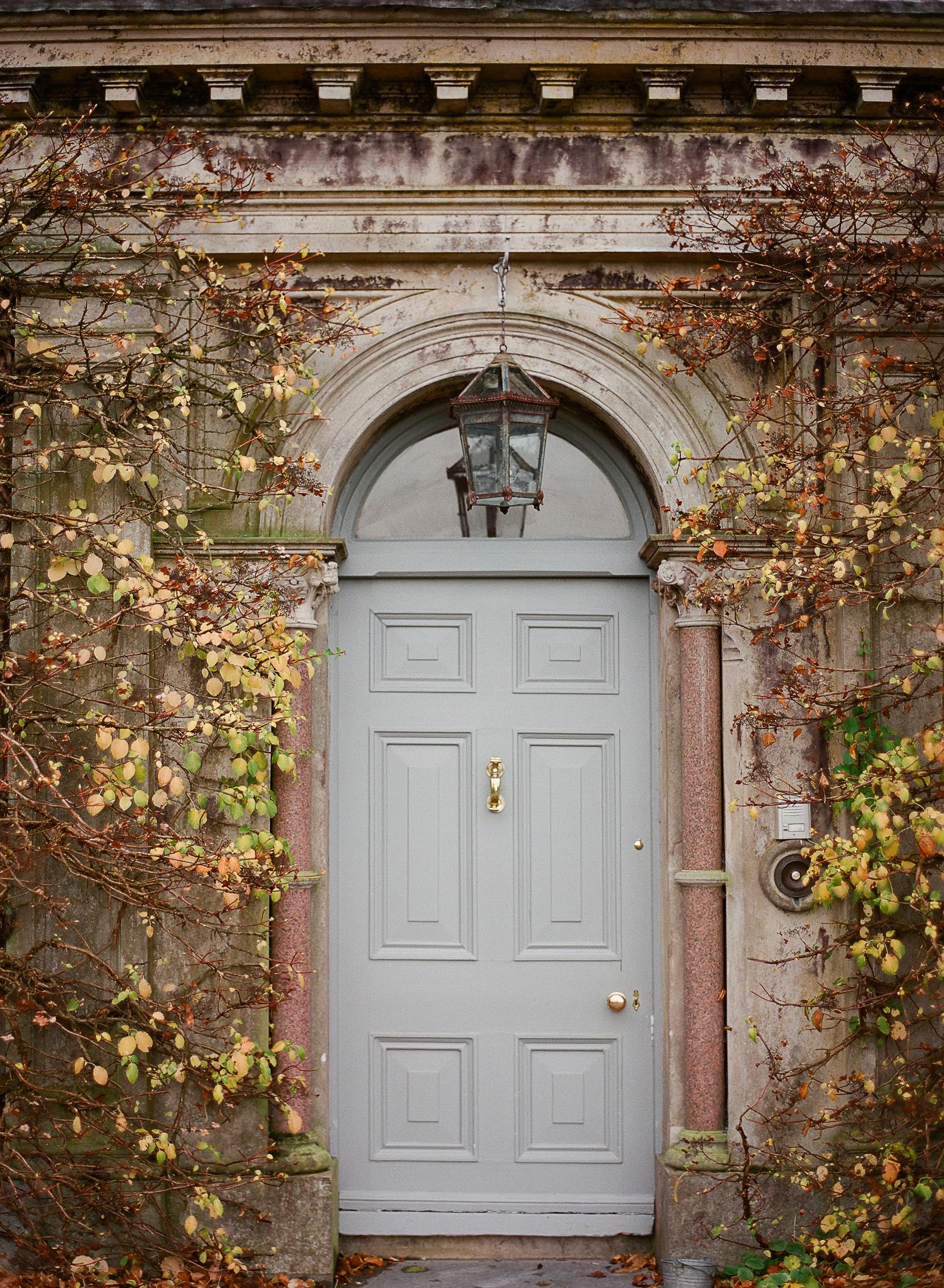 lauramurray-travel-destinationphotography-creativetravel-artists-filmphotography-unearthingtc-door-bluedoor-ballyvolanehouse.jpg