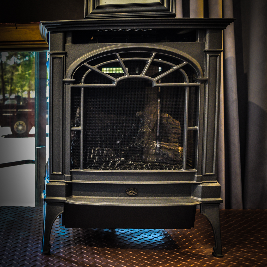 Lopi Northfield - ‧ Direct Vent Gas Stove - 22,000 BTU‧ New Iron Paint Finish‧ Cast Iron Body‧ Ember-Fyre Burner and Logs‧ Green Smart Remote Control‧ Fan‧ Window design‧ Top or rear exhaust