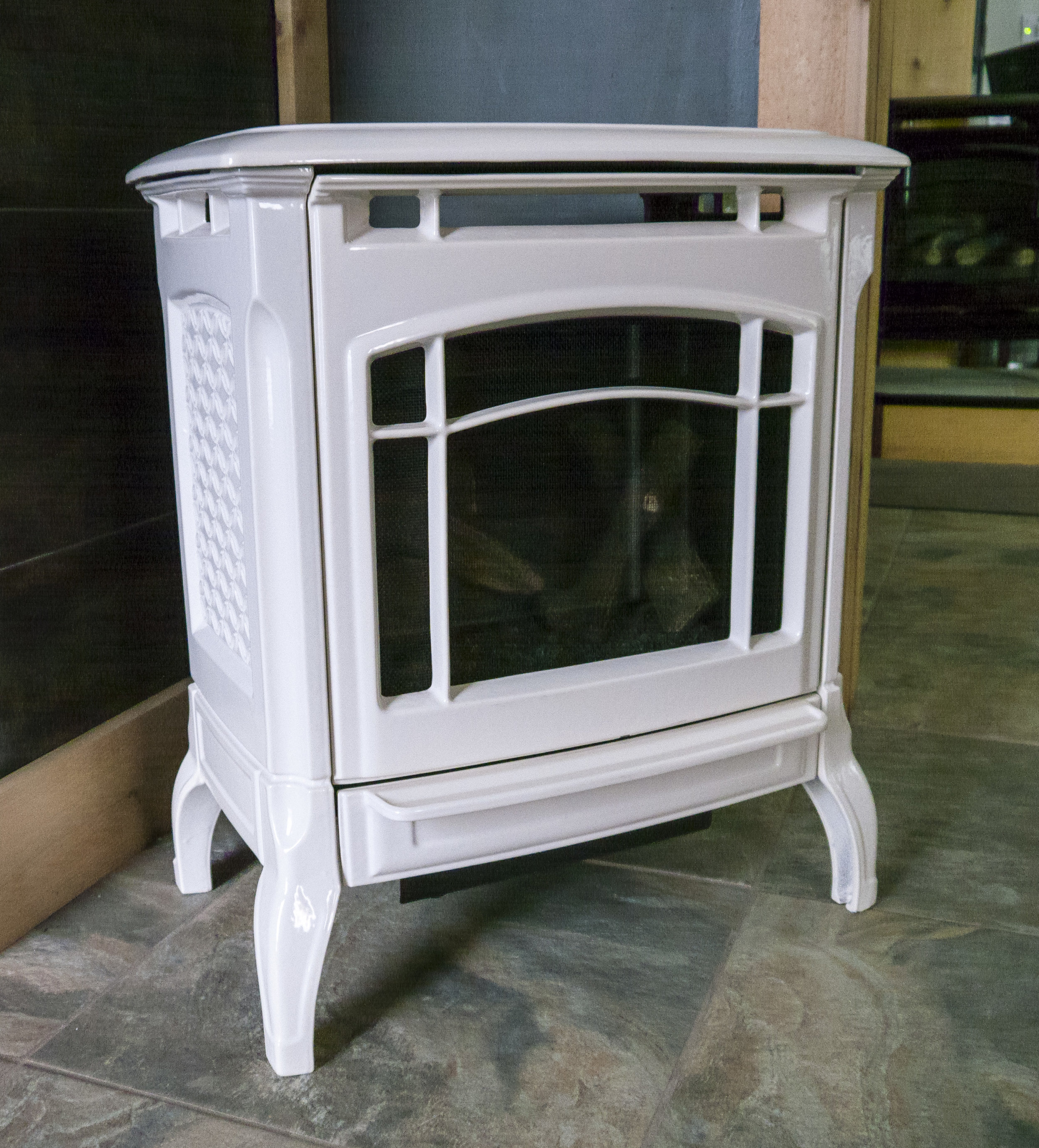 Hearthstone Stowe - ‧ Direct Vent Gas Stove - 22,400 BTU‧ Oyster Enamel‧ Cast Iron Body‧ Ceramic Logs And Burner‧ Maxitrol Remote Control‧ Fan – Not Included as shown; optional‧ Ideal small stove‧ Choice of Colors‧ Choice of Controls