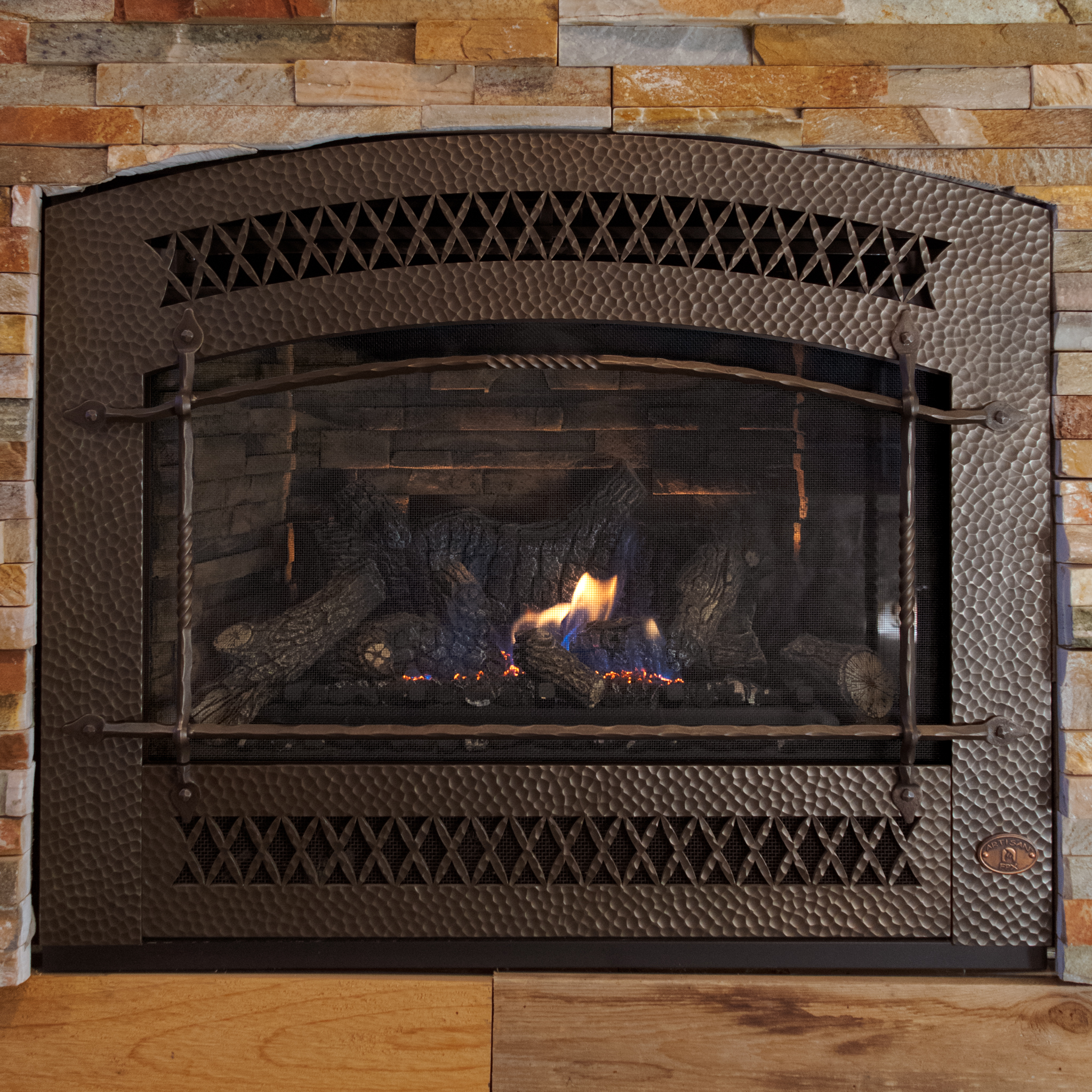 FireplaceX 564 HO - ‧ Direct Vent Gas Fireplace - 35,000 BTU‧ Ledgestone Firebox Panels‧ Artisan Front - Bronze‧ Ember-Fyre Burner with Logs‧ Green Smart Remote Control‧ Fan‧ Strong heater‧ Stylish hammered Artisan Front‧ Highly reliable