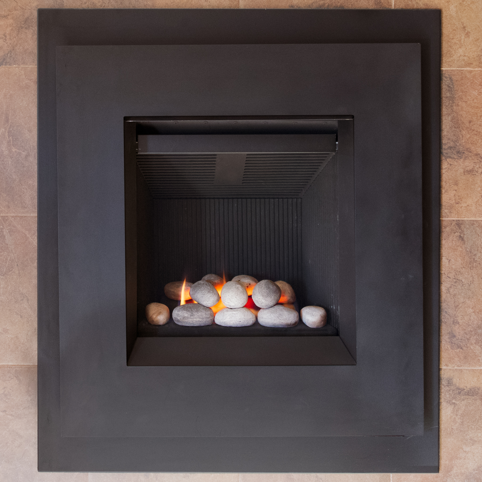 Valor Portrait Ledge - ‧ Direct Vent Gas Fireplace - 20,500 BTU‧ Black Fluted Firebox Panels‧ Black Face with Finishing Kit‧ Trim Panel‧ Rock Media Kit‧ Maxitrol Remote Control‧ Fan – Not Included‧ Vertically oriented firebox‧ Best suited for bedrooms – kitchens – offices