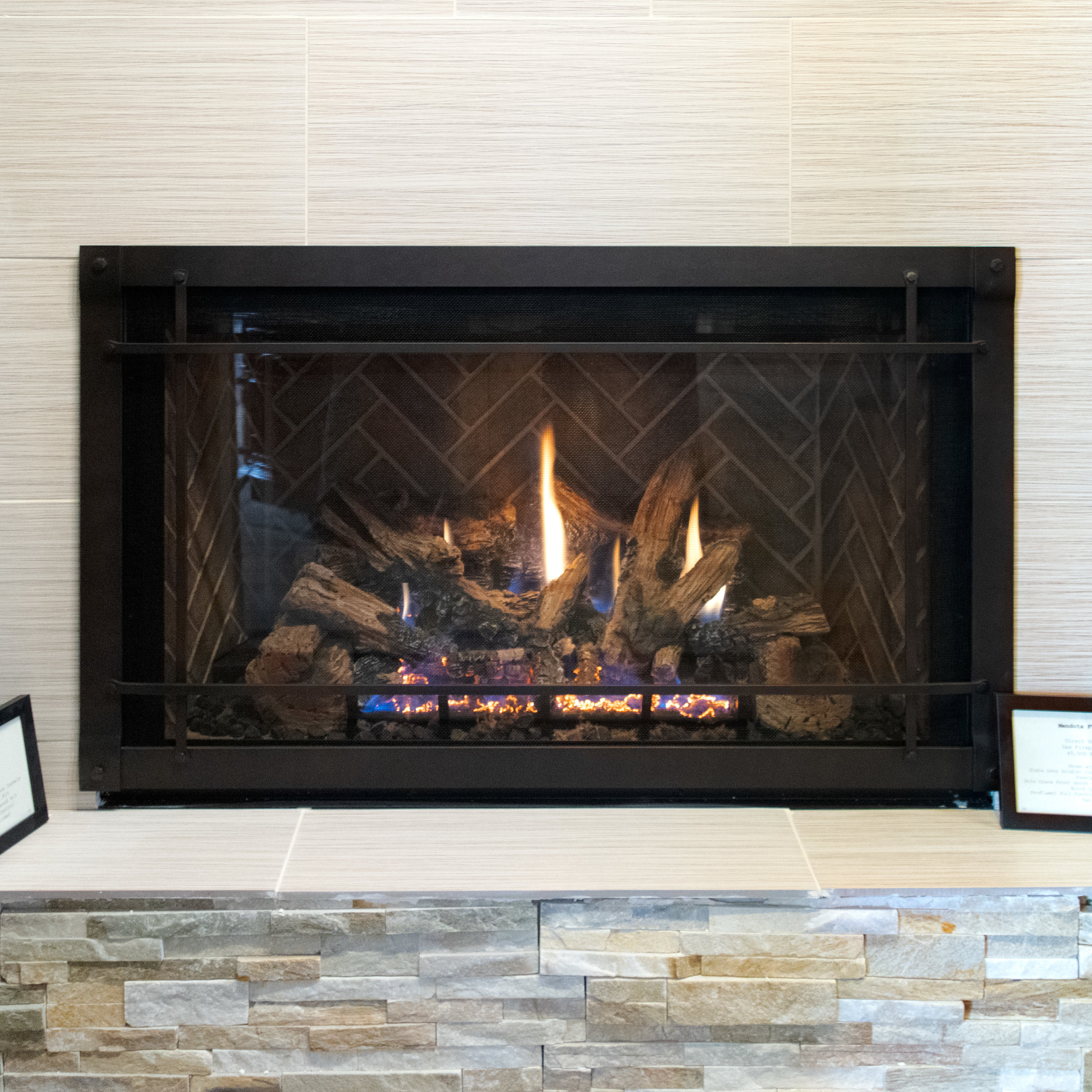 Mendota FV42 - ‧ Direct Vent Gas Fireplace - 44,000 BTU‧ Tavern Brown Herringbone Firebox Panels‧ Grace Wide Front W/ Accent Bars - Aged Leather‧ White Oak HD Logs‧ Proflame2 Full Function Remote Control‧ Fan‧ Superior Quality‧ Traditionally oriented Fullview firebox‧ Terrific heater‧ Large selection of Fronts – Colors