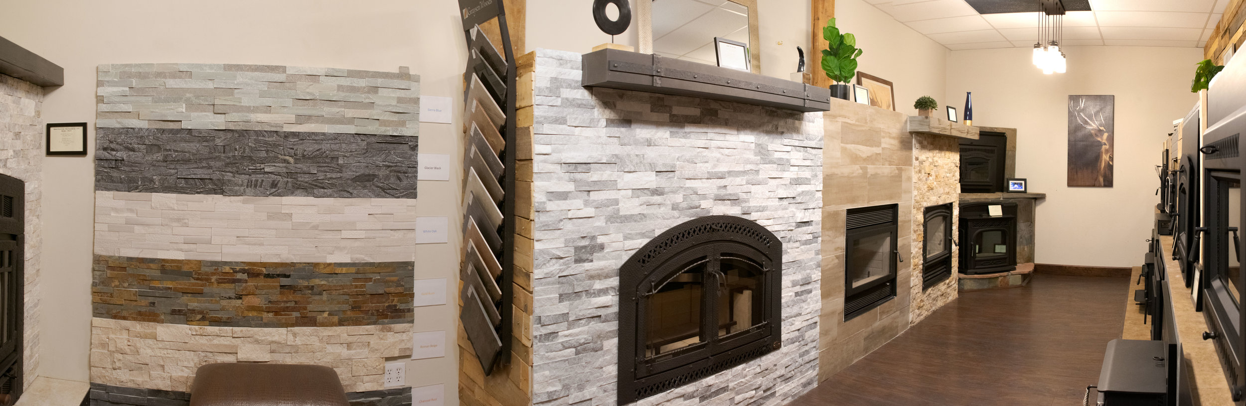 Wood burning fireplaces and inserts in our Evergreen Colorado showroom with tile and stonework done by our multi-talented technicians
