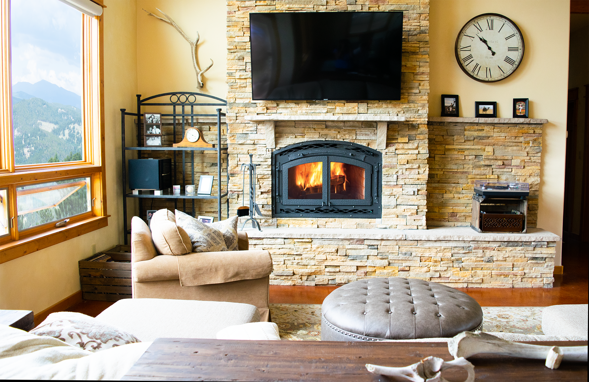 A large wood burning fireplace in a modern Colorado mountain home.
