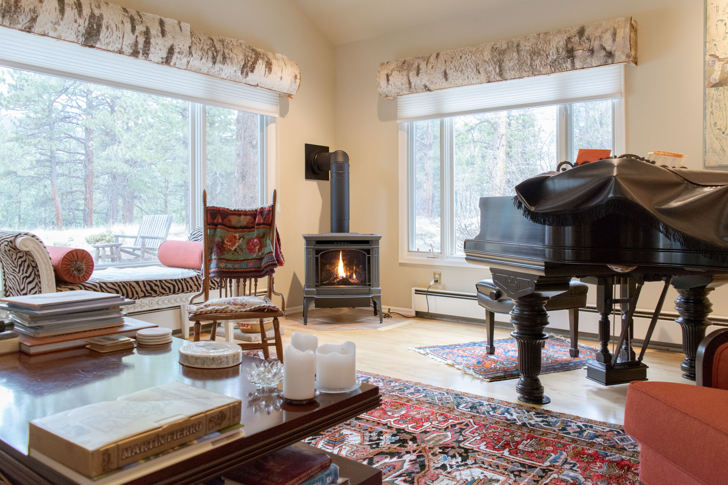 A Lopi Berkshire gas stove in the piano room of a palatially decorated Evergreen, CO home.