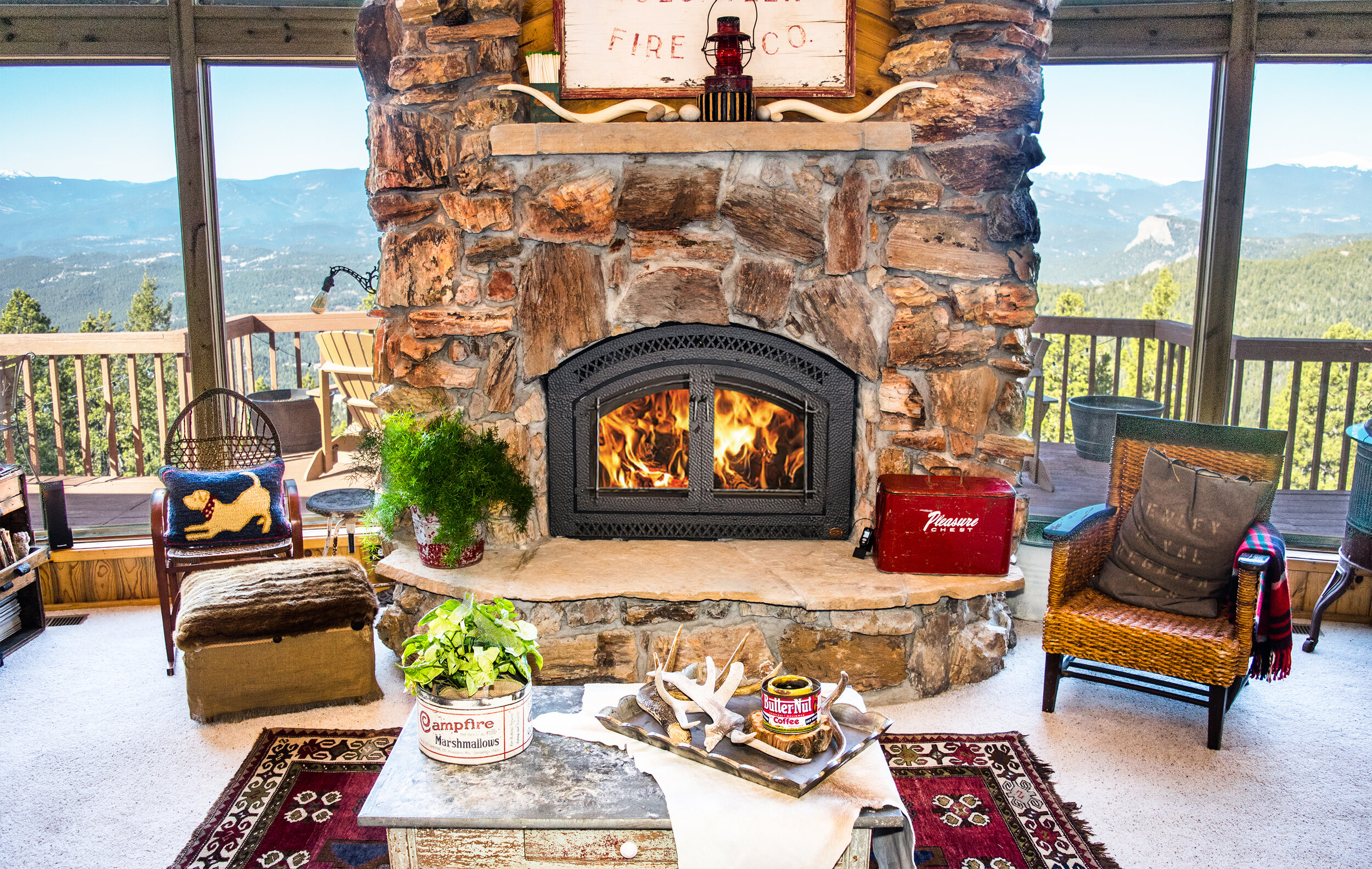 FireplaceX 44 Elite in a tradtional-style fireplace installation with a view of the mountains through the window.