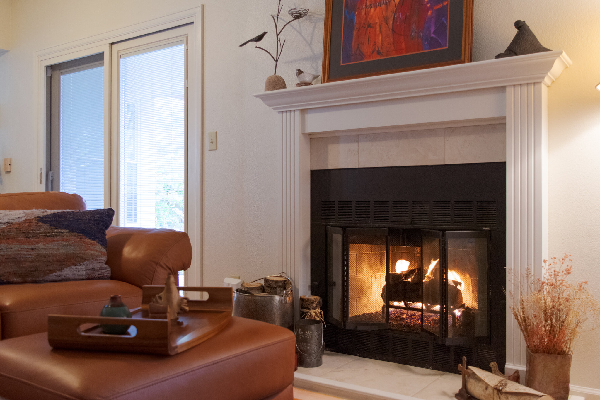 Hargrove Western Pine gas logs in a factory built fireplace with craftsman style pillars and mantel.
