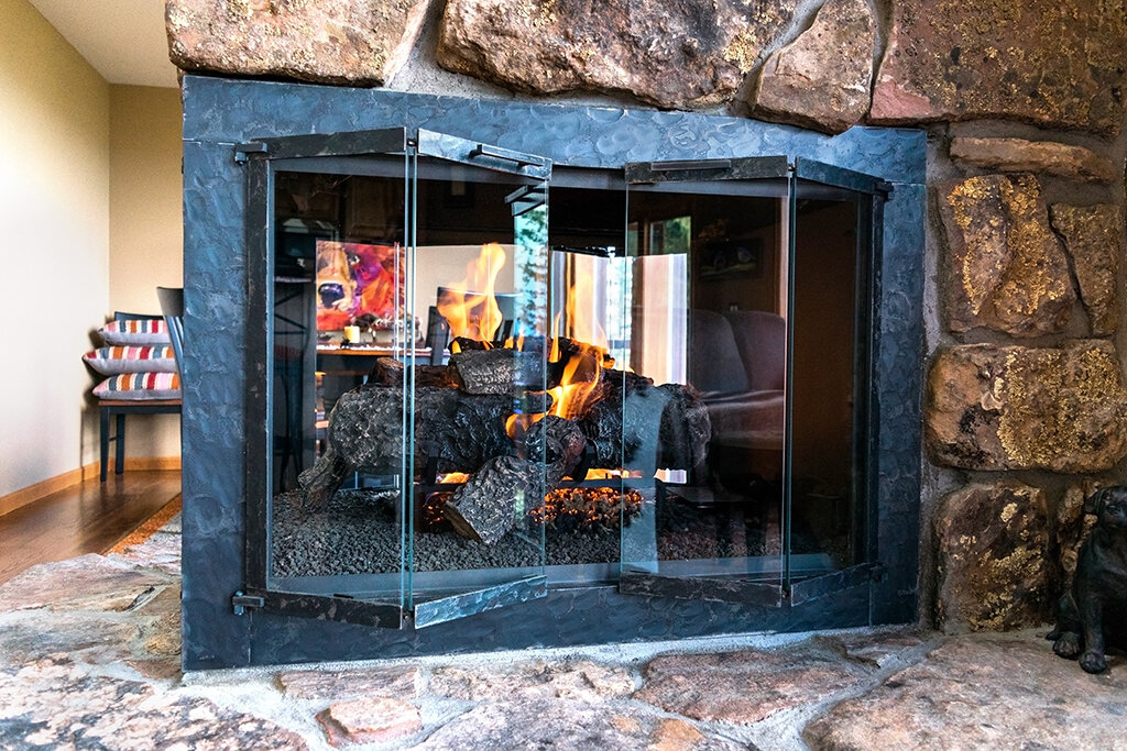Stoll Fireplace Doors on a see-through fireplace with Hargrove gas logs.