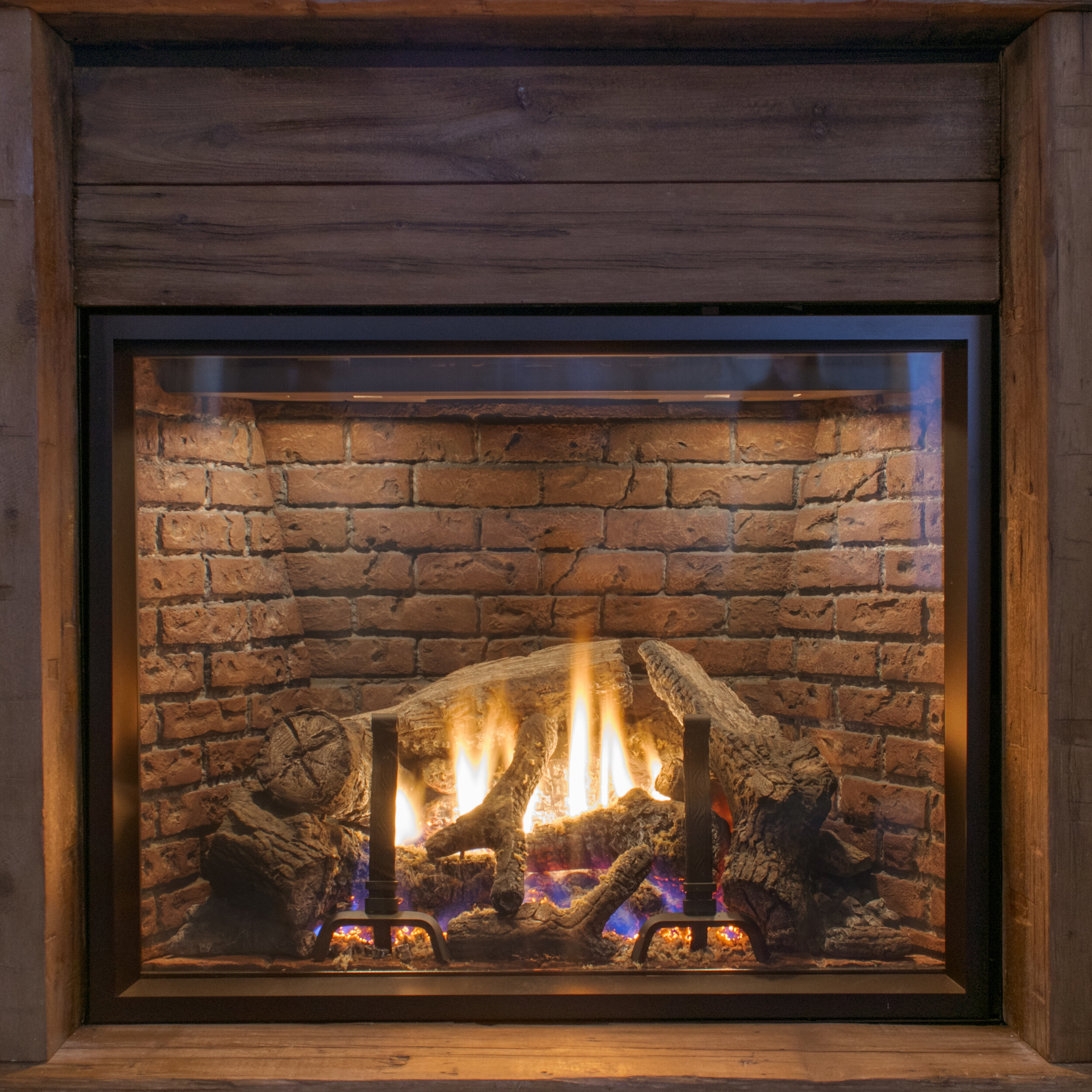 American Hearth Renegade 50 - · Direct Vent Gas Fireplace – 56,500 BTU· Fire Cracked Brick Firebox Panels· Clean Face Trim Kit· Forest Timber Log Set· Decorative Andirons· Optional Convection Fan· Quality gas fireplace· Impressive Log Set
