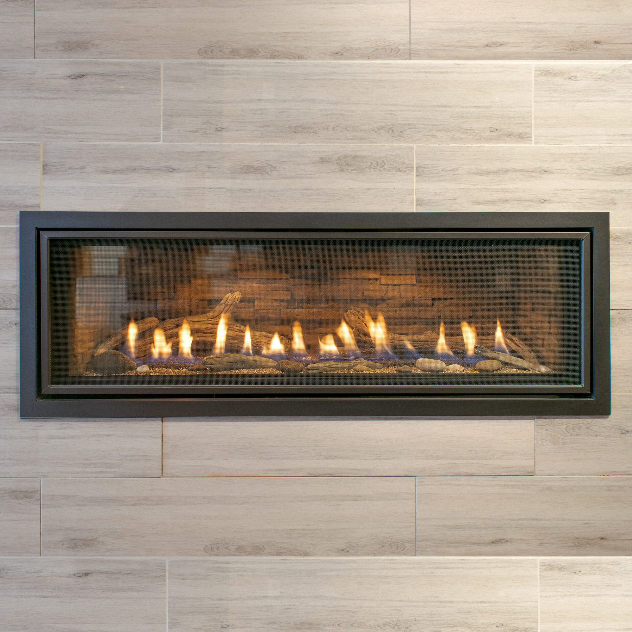 Kozy Heat Callaway 50 - ‧ Direct Vent Gas Fireplace - 35,500 BTU‧ Ledgerstone Firebox Panels‧ I-Piece Rectangle Surround‧ Beach Accent Kit‧ Accent Lighting‧ Proflame2 Full Function Remote Control‧ Fan‧ Trendy Linear Design