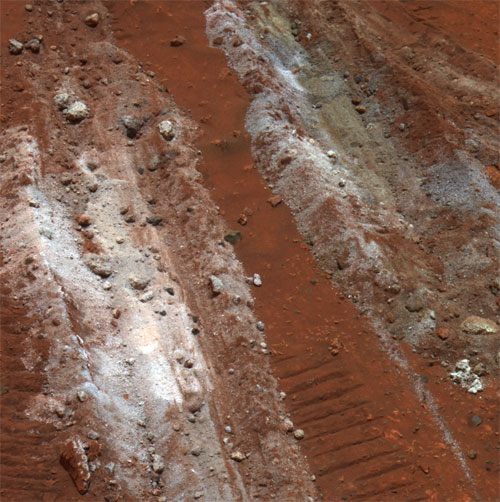 The shallow trench where Spirit's dragging wheel revealed fine-grained silica. Credit:  NASA