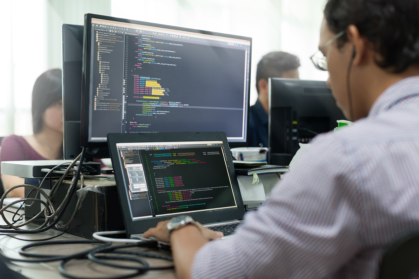 Developer working on desktop screen
