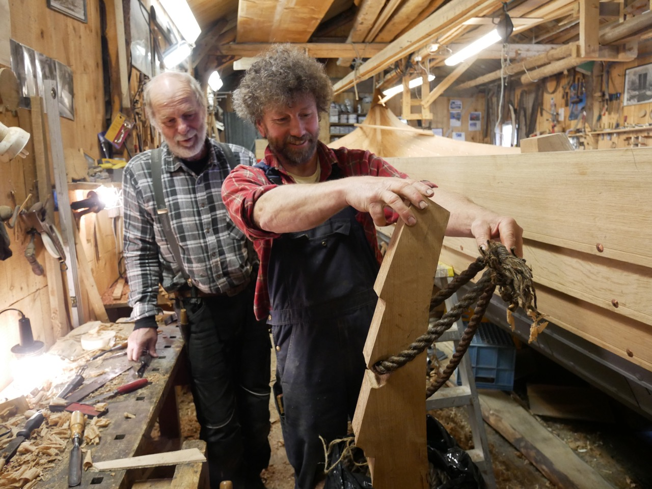 Gunnar and Arne-Terje checking the fit of the line on the frame I carved.