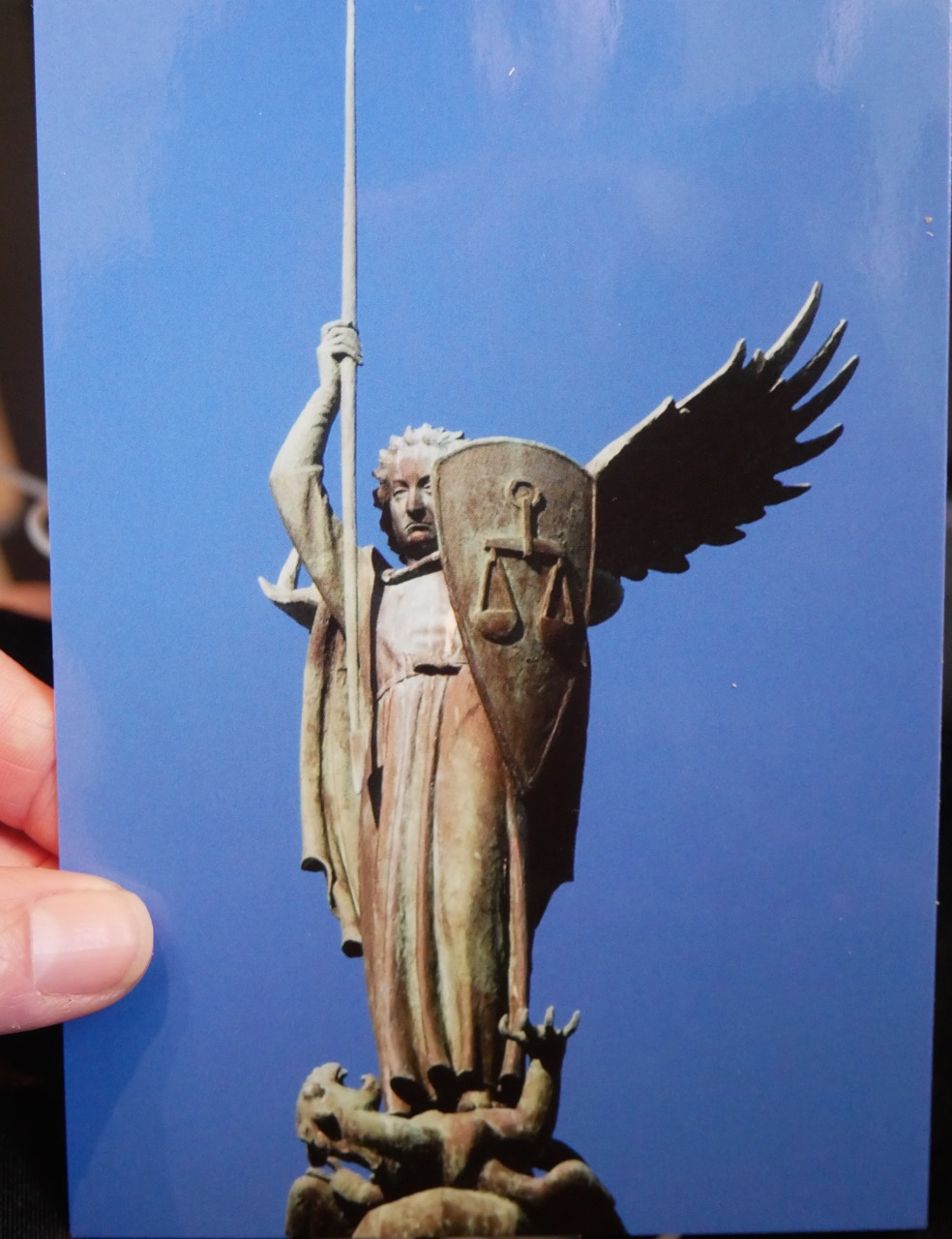 St. Michael as Bob Dylan, spearing a dragon, 1969. Photo of a postcard I purchased at the cathedral.