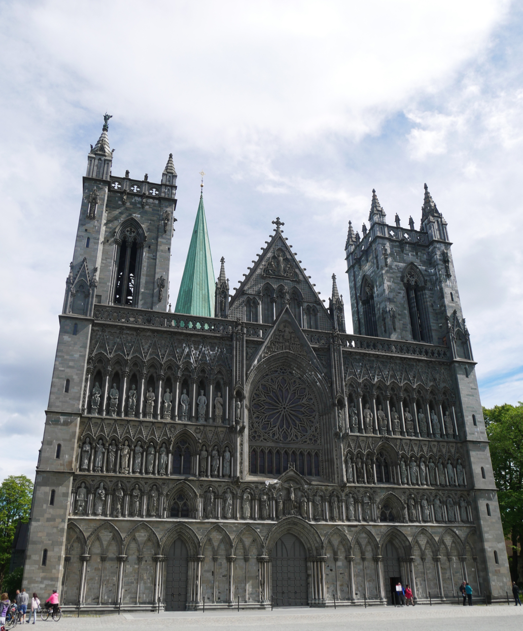 The western wall of Nidaros Cathedral, Trondheim. The St. Michael sculpture made by his father is on the top left turret.